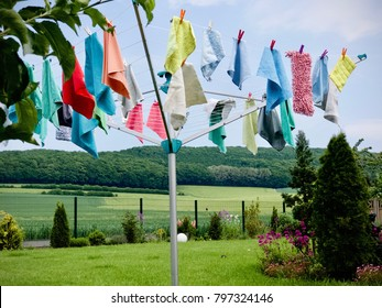 rotary clothes dryer with hanging cleaning cloths at spring cleaning