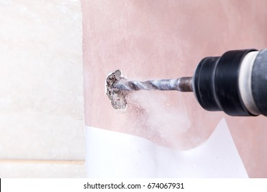 rotary hammer drills holes in the wall