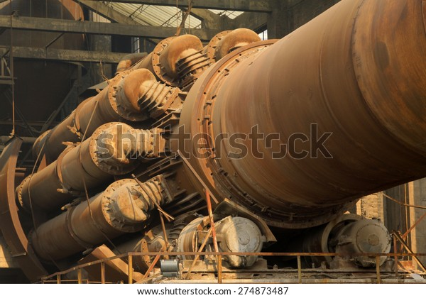 rotary kiln in a cement plant, closeup of photo