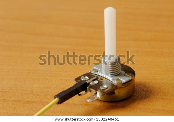 Rotary Potentiometer Yellow Wire On Wooden Stock Photo (Edit