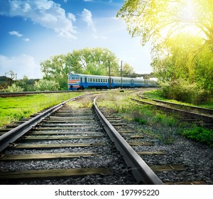 Rotate the railway with train under sunny skies