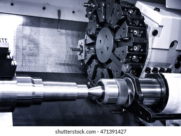 Rotating head with drilling machine bits and tools in a high precision mechanics plant at CNC lathe in workshop