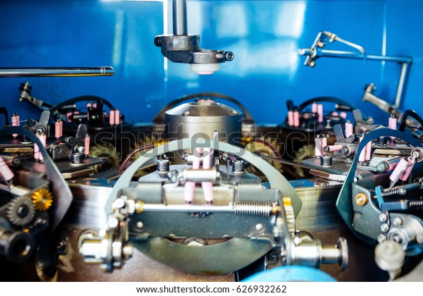Rotating mechanism of a vertical braiding machine. Abstract industrial background.
