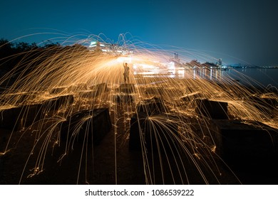 Rotating steel wool  makes visible the spark on the surface of the object.
