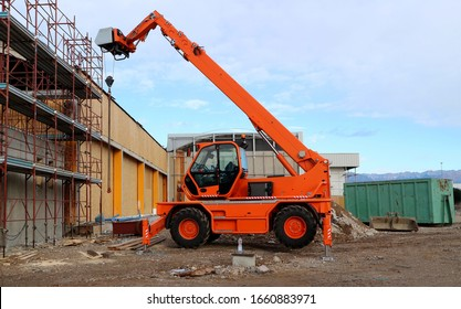 Rotating telehandler at work in a redevelopment area