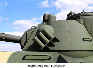 Rotating towerof the self-propelled  howitzer with  gun,  surveillance equipment and a system for setting smoke screens for shooting  smoke grenades