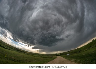 Rotation in the clouds of a supercell thunderstorm over the plains of eastern Wyoming, USA. Fisheye view.