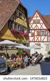 Rotenburg ob der Tauber, Germany - 2 July 2019: people drinking on a restaurant of Rotenburg ob der Tauber on Germany
