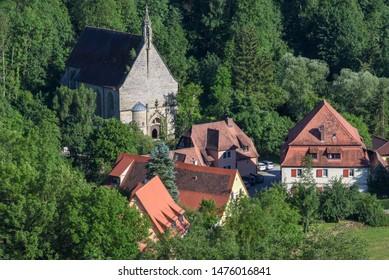 Rotenburg ob der Tauber, Germany - 2 July 2019: church and houses of Rotenburg ob der Tauber on Germany