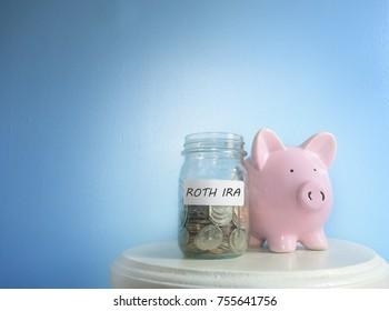 Roth IRA savings jar and piggy bank