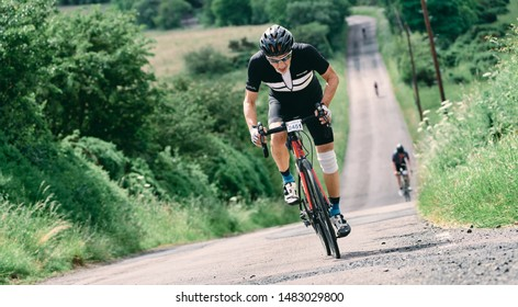 ROTHBURY, NEWCASTLE UPON TYNE, ENGLAND, UK - JULY 06, 2019: An elderly cyclist going fast up hill in the cyclone race event starting in Newcastle and going through Northumberland.