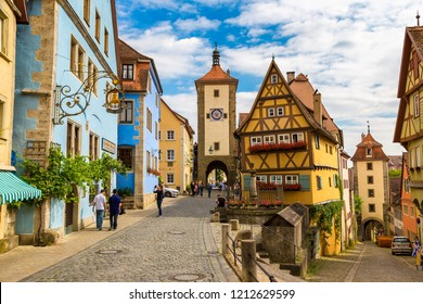 ROTHENBURG, GERMANY - JUNE 18, 2016: Medieval old street in Rothenburg ob der Tauber in a beautiful summer day, Germany on June 18, 2016