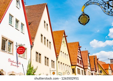 Rothenburg ob der Tauber, Bavaria, Germany - August 17 2018: Historic colorful half-timbered buildings line the streets of old town in Rothenburg ob der Tauber.
