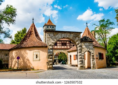 Rothenburg ob der Tauber, Bavaria, Germany - August 17 2018: Castle tower and city gate at the entrance to the old town of Rothenburg ob der Tauber.