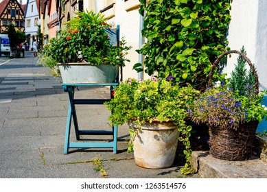 Rothenburg ob der Tauber, Bavaria, Germany - August 17 2018: Potted plants and flowers outside a building in the old town of Rothenburg ob der Tauber