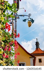 Rothenburg ob der Tauber, Bavaria, Germany - August 17 2018: A sign with gold grapes hangs outside a building in the old town of Rothenburg ob der Tauber, Germany.