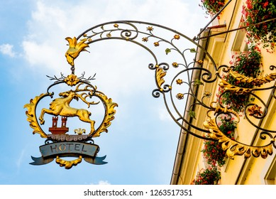Rothenburg ob der Tauber, Bavaria, Germany - August 17 2018: A sign for a hotel hangs off a building in the old town of Rothenburg ob der Tauber, Germany.