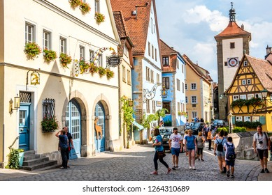 Rothenburg ob der Tauber, Bavaria,  Germany - August 17 2018: View of The Plönlein (Little Square) and Siebers Tower, famous historic landmarks, in Rothenburg ob der Tauber, Germany.
