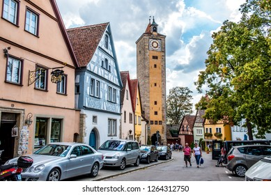Rothenburg ob der Tauber, Bavaria,  Germany - August 17 2018: View of The Burgturm, the tallest of all the gate towers and a famous historic landmark, in Rothenburg ob der Tauber, Germany.