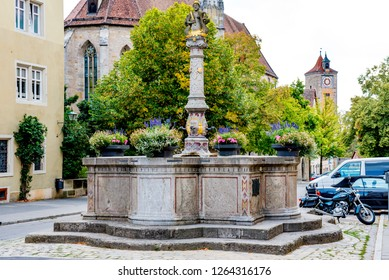 Rothenburg ob der Tauber, Bavaria, Germany - August 17 2018: A fountain located in a little square in the old town of Rothenburg ob der Tauber, Germany.