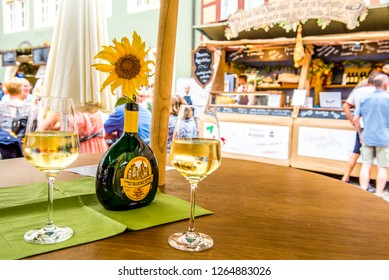 Rothenburg ob der Tauber, Bavaria, Germany - August 17 2018: Table set with wine glasses during the annual Wine Festival in Rothenburg ob der Tauber, Germany.