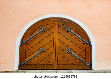 Rothenburg ob der Tauber, Bavaria, Germany - August 17 2018: Wooden curved door on the cobblestoned streets of Rothenburg ob der Tauber, Germany