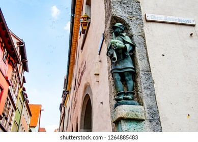 Rothenburg ob der Tauber, Bavaria, Germany - August 17 2018: Statue on the corner of a historic building in the old town of Rothenburg ob der Tauber, Germany