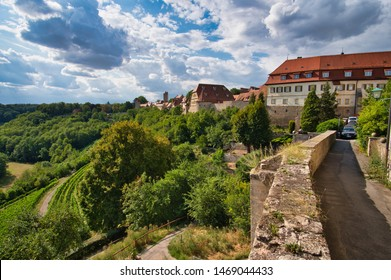 Rothenburg ob der Tauber, Bavaria / Germany - August 2, 2019: Along the historic city wall in Rothenburg ob der Tauber with wine yard