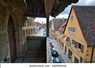 Rothenburg ob der Tauber, Bavaria / Germany - August 2, 2019: View form the historic city wall to the old town of Rothenburg ob der Tauber