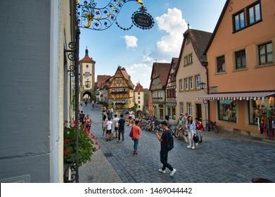 Rothenburg ob der Tauber, Bavaria / Germany - August 2, 2019: Historic old town of Rothenburg ob der Tauber with the famous view to Kobolzeller Tor