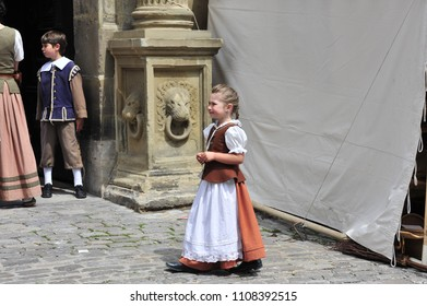 Rothenburg ob der Tauber, Bavaria/Germany- 05/18/2018: A little boy and girl dressed in historical costumes participate in Rothenburg's Medieval Festival.