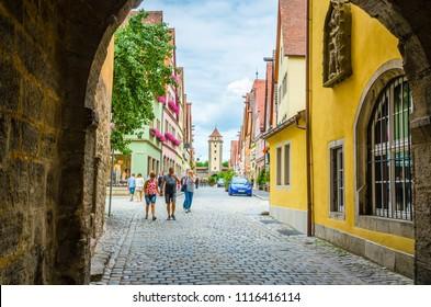 ROTHENBURG OB DER TAUBER, GERMANY, 17 JULY, 2017: Beautiful streets in Rothenburg ob der Tauber with traditional German houses, Bavaria, Germany