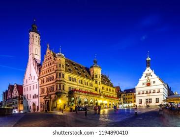 ROTHENBURG OB DER TAUBER, GERMANY - JULY 29, 2016: Old Town Hall (Rathaus) on the Market Place (Marktplatz) of the historic town of Rothenburg ob der Tauber, Bavaria, Germany.