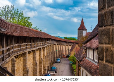 Rothenburg ob der Tauber, Germany - MAY 2010: Panoramic view of the walkable battlements leading to a fortification tower. The well preserved medieval town fortification is a popular tourist site.