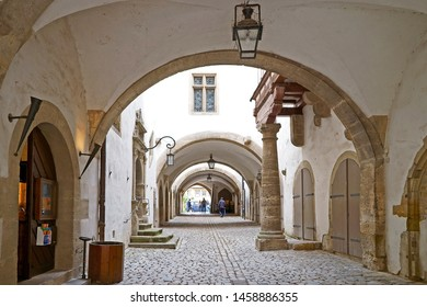 Rothenburg ob der Tauber, Germany - June 12th, 2019: Famous arcades in ancient Rothenburg ob der Tauber at the Romantic Road (Romantische Strasse) in Germany