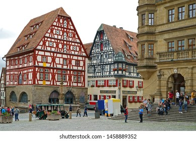 Rothenburg ob der Tauber, Germany - June 12th, 2019: Famous ancient half-timbered houses in Rothenburg ob der Tauber at the Romantic Road in Germany
