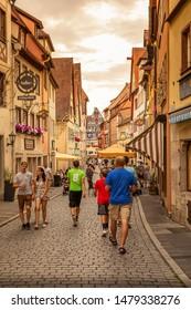 Rothenburg ob der tauber / Germany - July 27 2019:  Beautiful streets in Rothenburg ob der Tauber with traditional German houses, Bavaria, Germany.