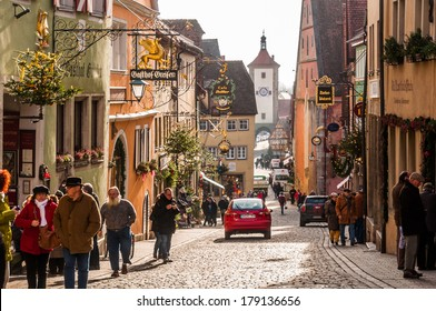 ROTHENBURG OB DER TAUBER, GERMANY - DECEMBER 3 2013:  Rothenburg Ob Der Tauber is a well preserved medieval german town, and a UNESCO heritage site which attracts over 2 million visitors every year.
