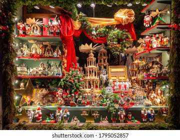 Rothenburg ob der Tauber, Germany - December 23, 2019: Christmas showcase with toys in night illumination. Rothenburg ob der Tauber. Bavaria Germany.