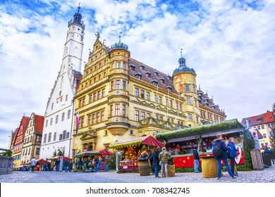 ROTHENBURG OB DER TAUBER, GERMANY - December 13, 2016: Christmas Market in the Old Town Hall Square (Rathaus) in the old fairytale town in Bavaria