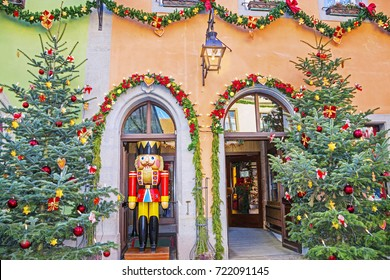 ROTHENBURG OB DER TAUBER, GERMANY - December 13, 2016: Christmas trees and a wooden toy The Nutcracker at a traditional Christmas market of old fairytale town of Rothenburg ob der Tauber, Bavaria.