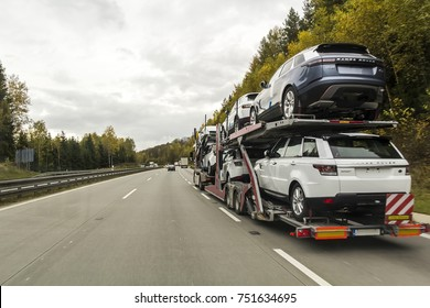 Rothenburg ob der Tauber, Germany - October 12, 2017: The trailer truck transports brand new cars on highway.