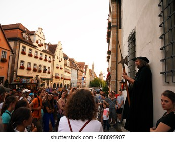 ROTHENBURG O.D.T., GERMANY - July 20, 2016: The Night Watchman Tour at Marktplatz