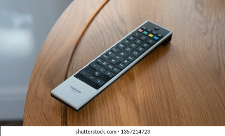 Rotherham, England / The United Kingdom - April 2nd 2019 : Toshiba Black and Silver TV Remote Control