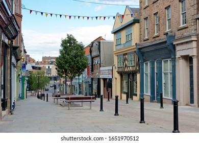 ROTHERHAM, UK - AUGUST 8, 2018: Cental street in Rotherham, a large minster town in South Yorkshire.