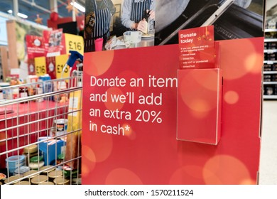 ROTHERHAM, UK – NOVEMBER 22, 2019: Sign and donation leaflets at the Tesco supermarket national food bank collection for Trussell Trust foodbanks
