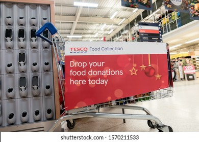 ROTHERHAM, UK – NOVEMBER 22, 2019: A trolley for donations at the Tesco supermarket national food bank collection for Trussell Trust foodbanks