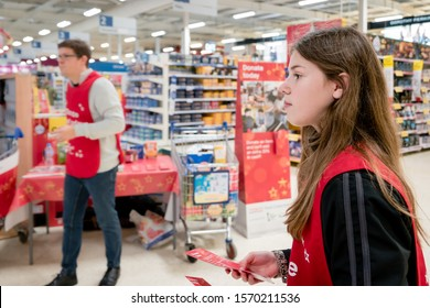 ROTHERHAM, UK – NOVEMBER 22, 2019: Volunteers ready to give donation leaflets to shoppers at the Tesco supermarket national food bank collection