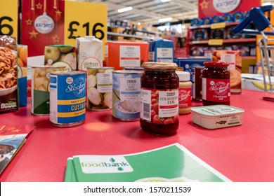 ROTHERHAM, UK – NOVEMBER 22, 2019: A display stand at the Tesco supermarket national food bank collection for Trussell Trust foodbanks