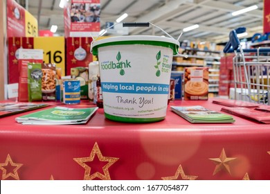 ROTHERHAM, UK – NOVEMBER 22, 2019: A charity money bucket for donations at the national food bank collection for Trussell Trust foodbanks